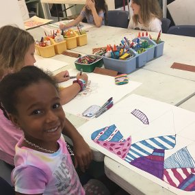 young african american girl smiling in art class