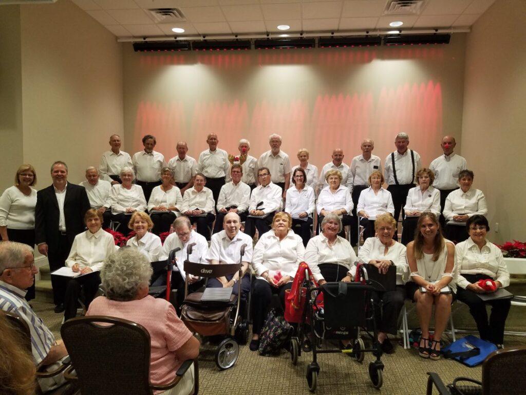 singing group in white shirts